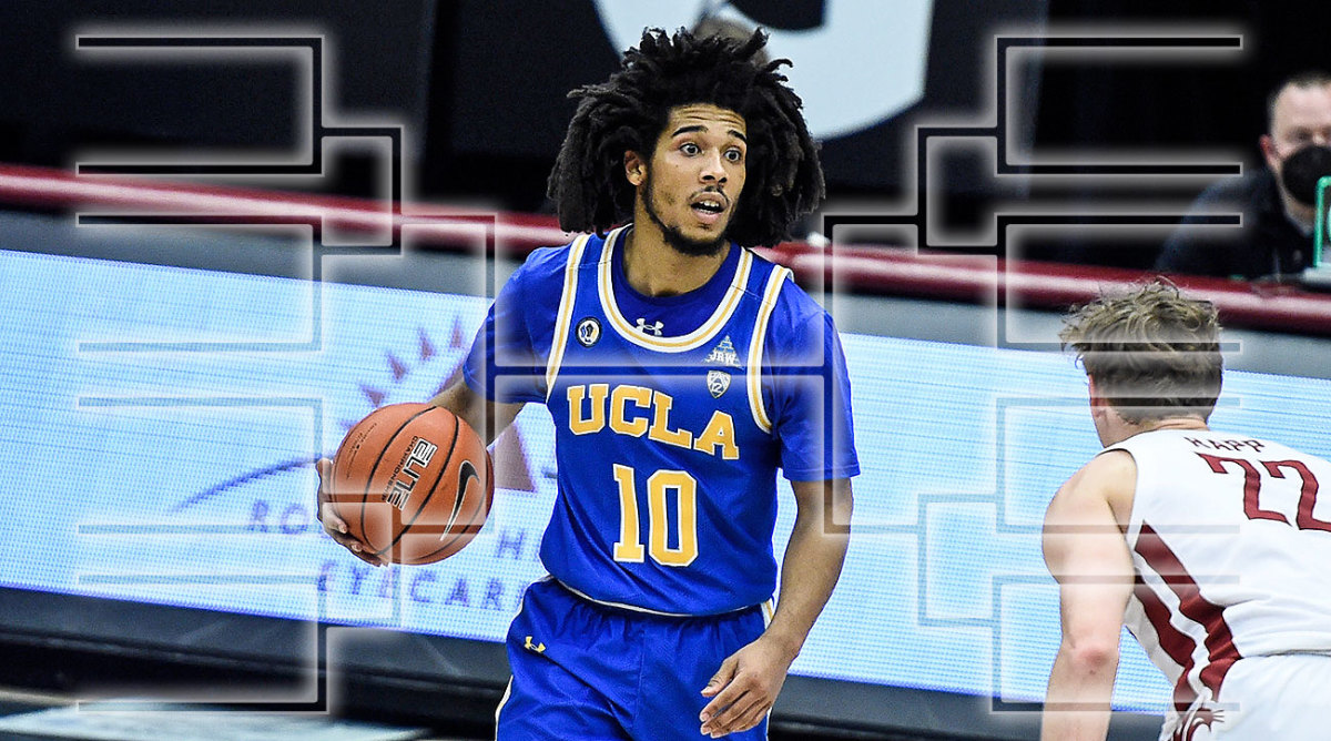 UCLA guard Tyger Campbell dribbles
