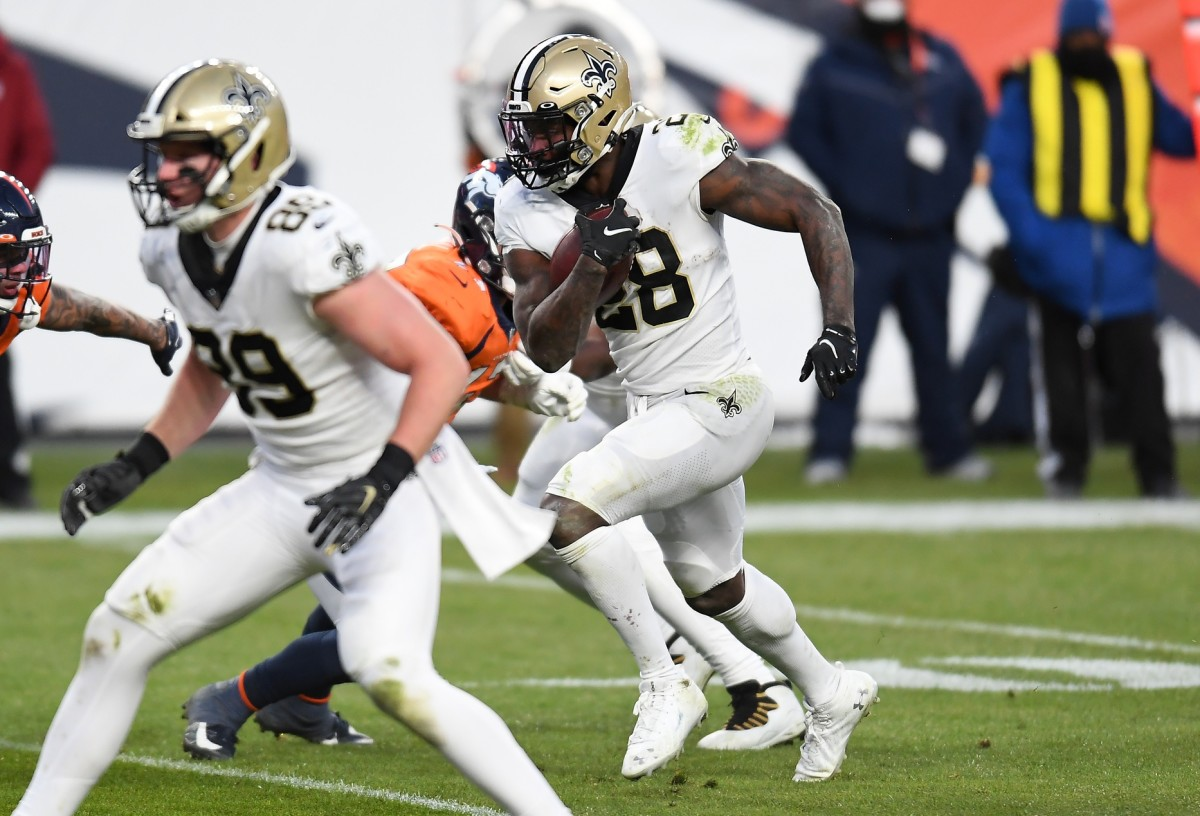 Nov 29, 2020; Denver, Colorado, USA; New Orleans running back Latavius Murray (28) carries for a touchdown in the fourth quarter against the Denver Broncos. Mandatory Credit: Ron Chenoy-USA TODAY