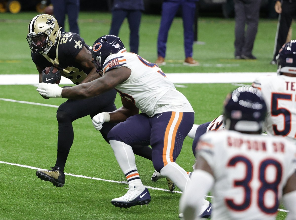 Jan 10, 2021; New Orleans, Louisiana, USA; Saints running back Latavius Murray (28) runs the ball against Chicago nose tackle Bilal Nichols (98) during the second half in the NFC Wild Card. Mandatory Credit: Derick E. Hingle-USA TODAY