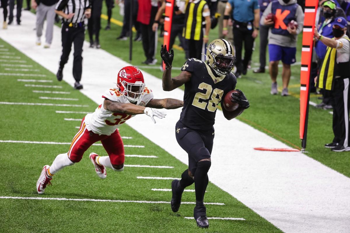 Dec 20, 2020; New Orleans, Louisiana, USA; Saints running back Latavius Murray (28) scores past Chiefs cornerback Charvarius Ward (35) at the Mercedes-Benz Superdome. Mandatory Credit: Derick E. Hingle-USA TODAY
