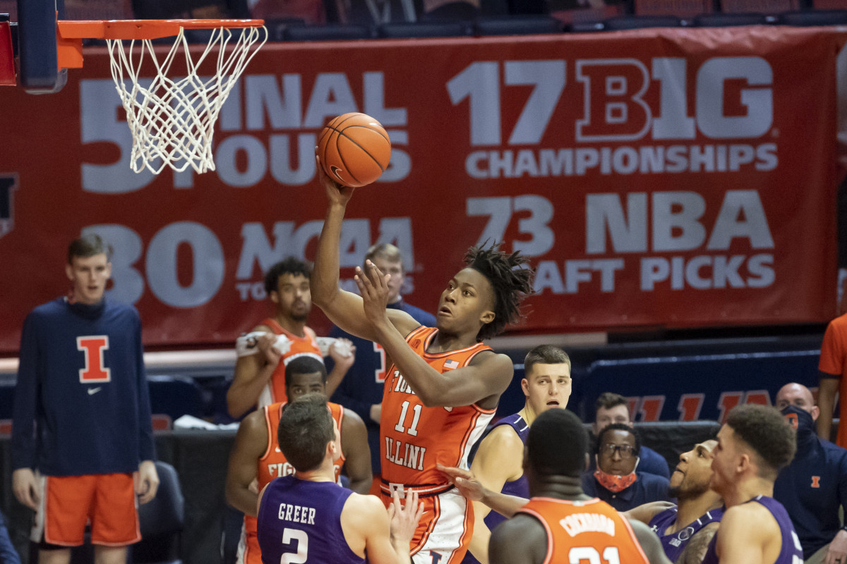 Illinois Fighting Illini guard Ayo Dosunmu (11) shoots against the Northwestern Wildcats during the second half at the State Farm Center.