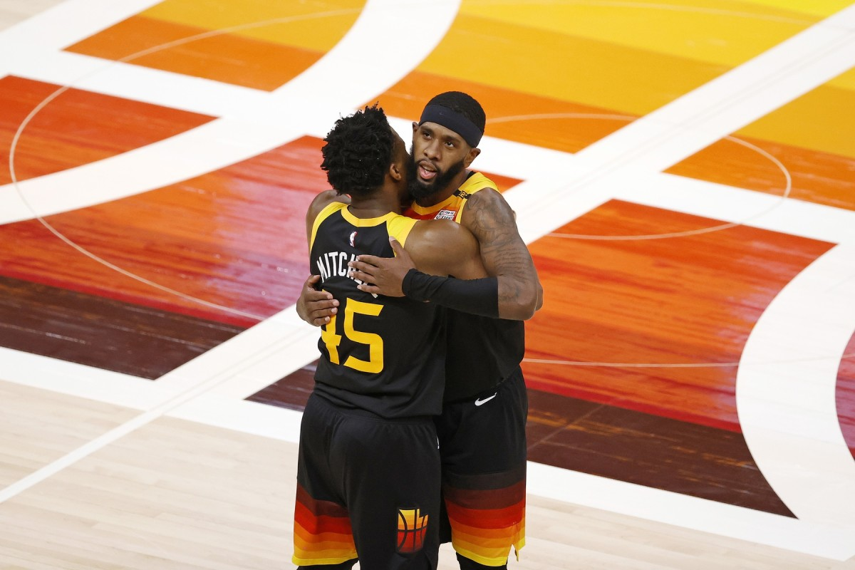 Donovan Mitchell (45) and Royce O'Neale (23) embrace at mid-court