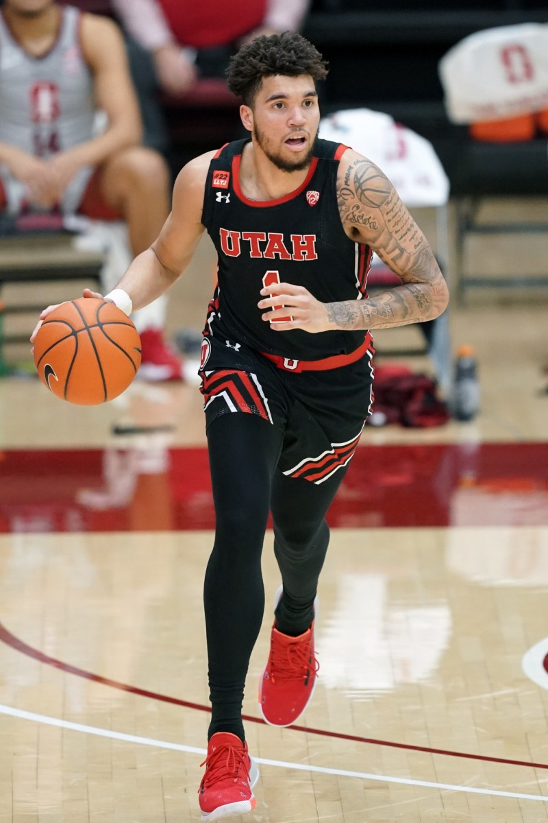 Feb 13, 2021; Stanford, California, USA; Utah Utes forward Timmy Allen (1) dribbles during the second half against the Stanford Cardinal at Maples Pavilion.