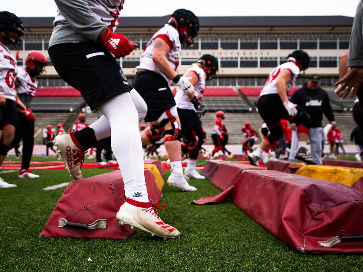Jacksonville State football players run through drills