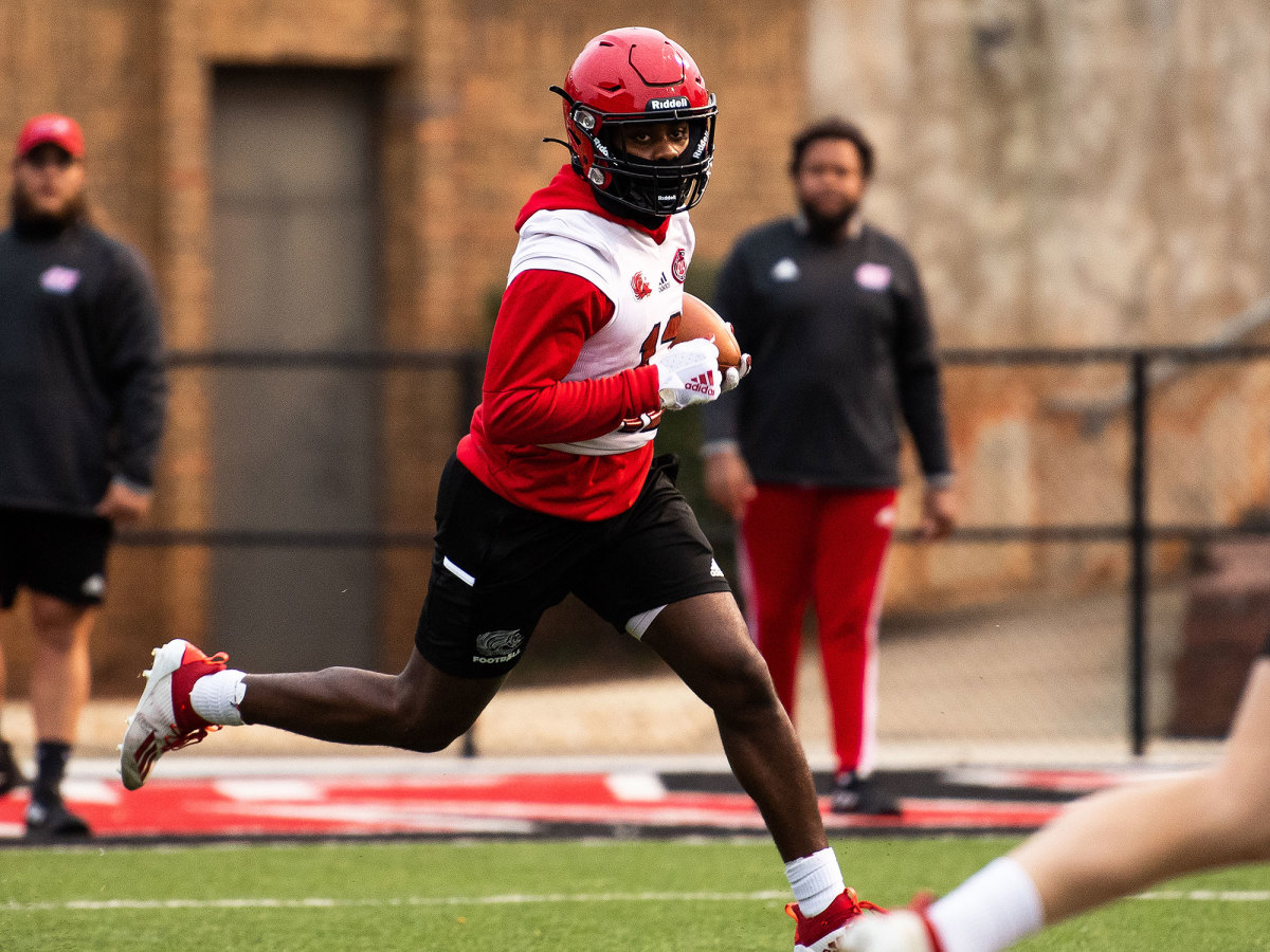 A Jacksonville State player runs with the ball at practice