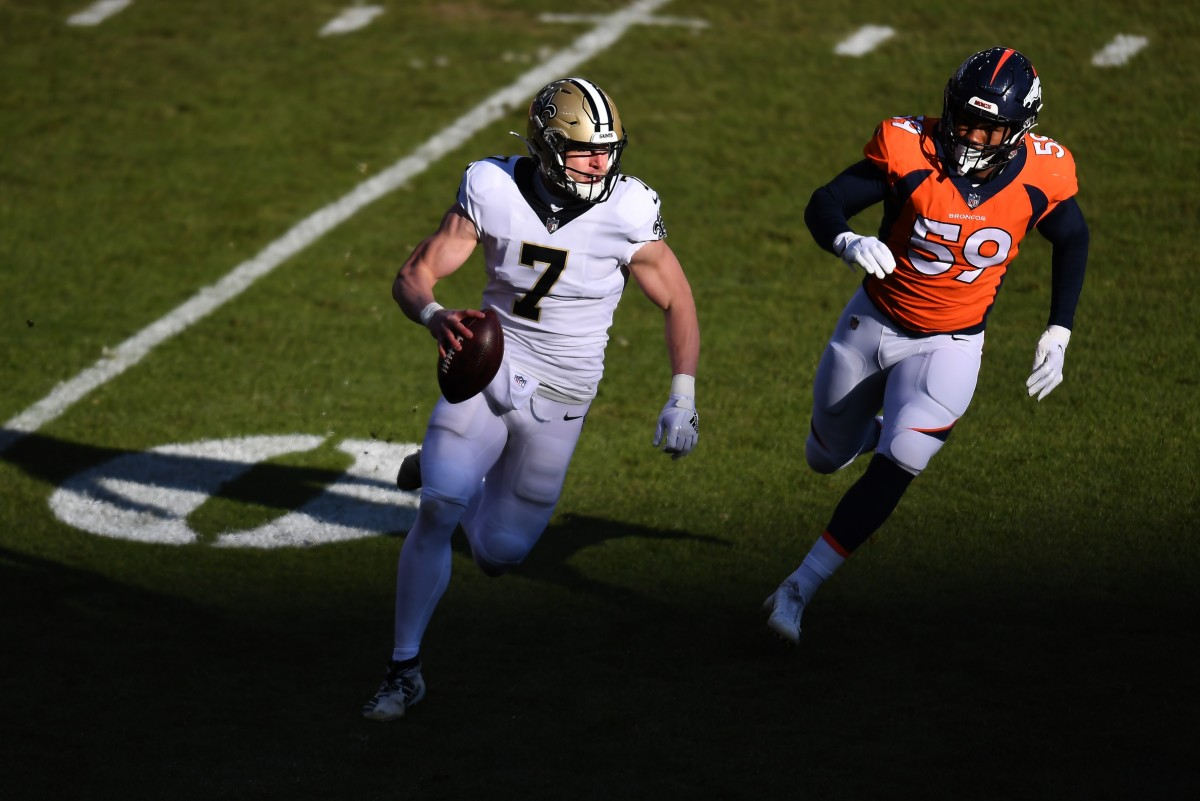 Nov 29, 2020; Denver, Colorado, USA; Broncos outside linebacker Malik Reed (59) chases New Orleans quarterback Taysom Hill (7) at Empower Field at Mile High. Mandatory Credit: Ron Chenoy-USA TODAY
