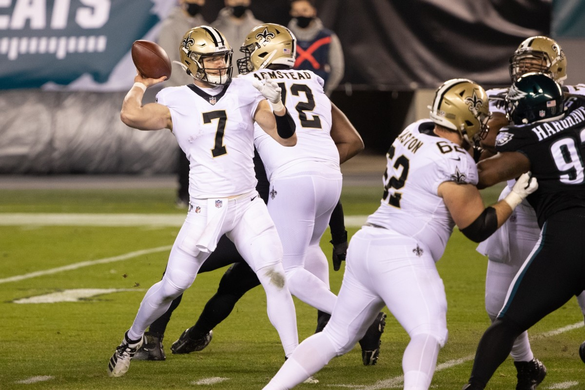 Dec 13, 2020; Philadelphia, Pennsylvania, USA; New Orleans quarterback Taysom Hill (7) passes the ball against the Eagles at Lincoln Financial Field. Mandatory Credit: Bill Streicher-USA TODAY