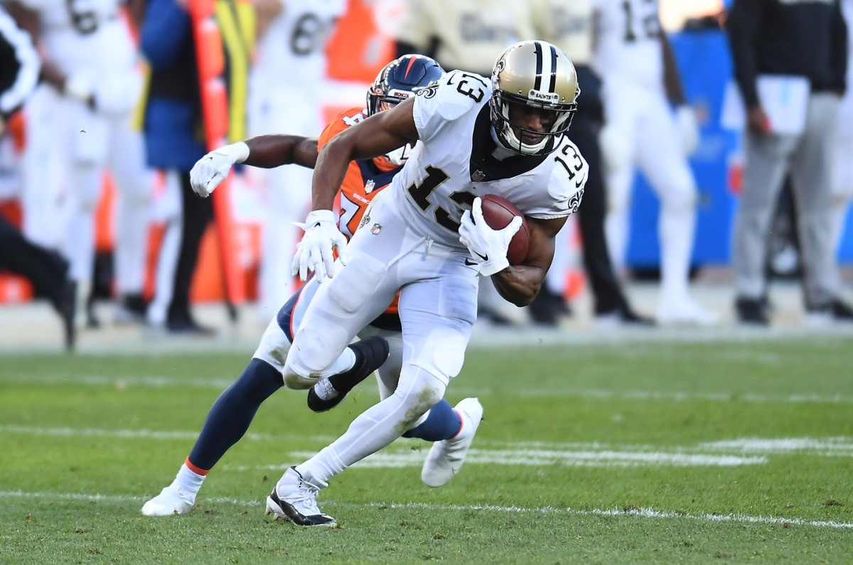 Nov 29, 2020; Denver, Colorado, USA; New Orleans wide receiver Michael Thomas (13) carries the ball against the Denver Broncos at Empower Field at Mile High. Mandatory Credit: Ron Chenoy-USA TODAY