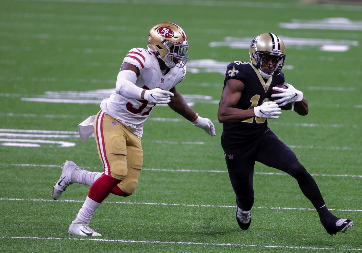 Nov 15, 2020; New Orleans, Louisiana, USA; Saints wide receiver Michael Thomas (13) runs from 49ers linebacker Dre Greenlaw (57) at the Mercedes-Benz Superdome. Mandatory Credit: Derick E. Hingle-USA TODAY