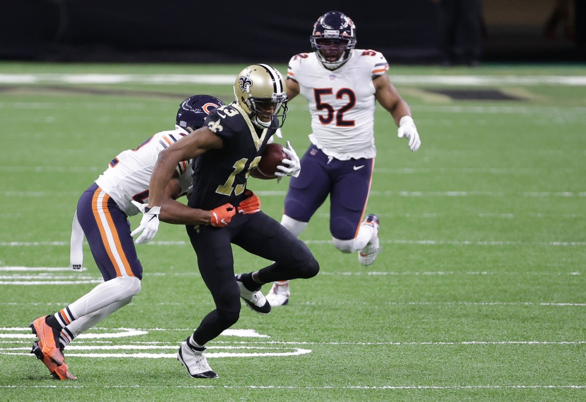 Jan 10, 2021; New Orleans, Louisiana, USA; Saints wide receiver Michael Thomas (13) runs the ball against the Bears during the first half in the NFC Wild Card game at Mercedes-Benz Superdome. Mandatory Credit: Derick E. Hingle-USA TODAY