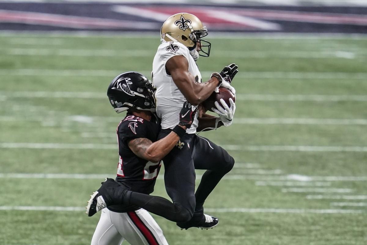 Dec 6, 2020; Atlanta, Georgia, USA; Saints wide receiver Michael Thomas (13) catches a pass over Falcons cornerback A.J. Terrell (24) at Mercedes-Benz Stadium. Mandatory Credit: Dale Zanine-USA TODAY