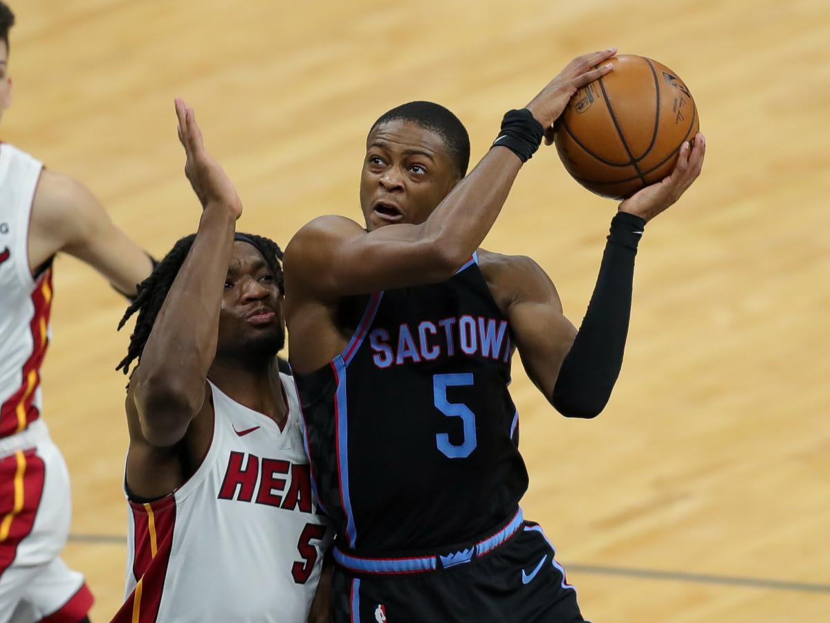 Sacramento Kings guard De'Aaron Fox (5) shoots the ball against Miami Heat forward Precious Achiuwa (5) during the third quarter at Golden 1 Center.