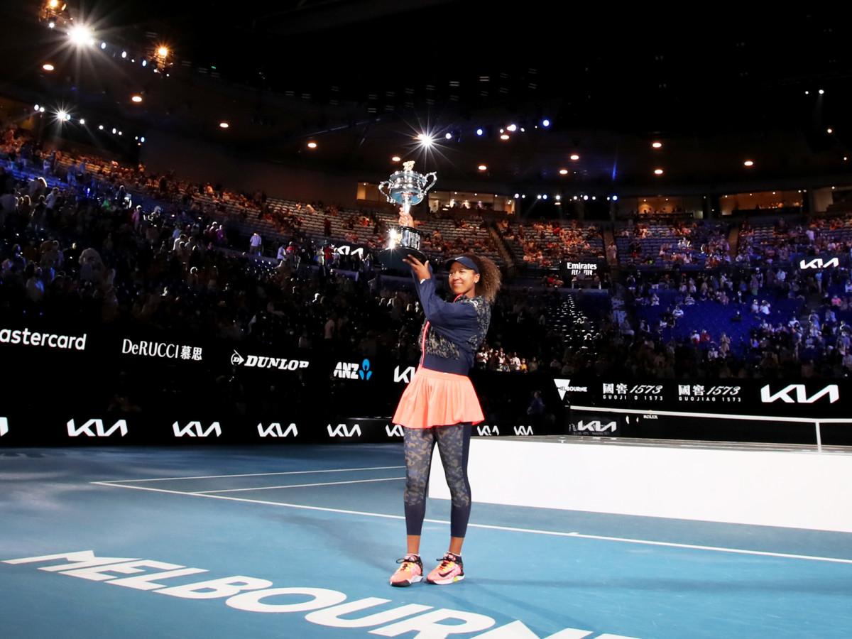 Naomi Osaka celebrates after winning the 2021 Australian Open over Jennifer Brady.