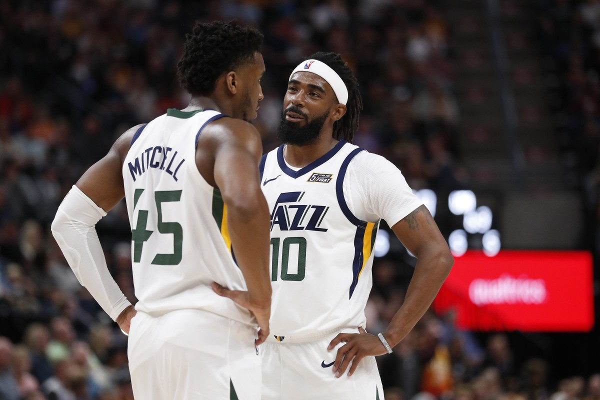 Donovan Mitchell (45) and Mike Conley (10) have a chat during a stoppage in play.