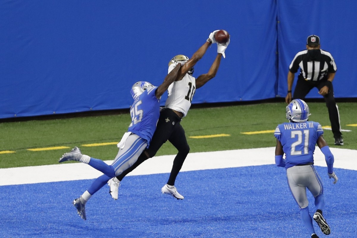 Oct 4, 2020; Detroit, Michigan, USA; New Orleans wide receiver Tre'Quan Smith (10) makes a jumping touchdown catch against Lions safety Will Harris (25) at Ford Field. Mandatory Credit: Raj Mehta-USA TODAY