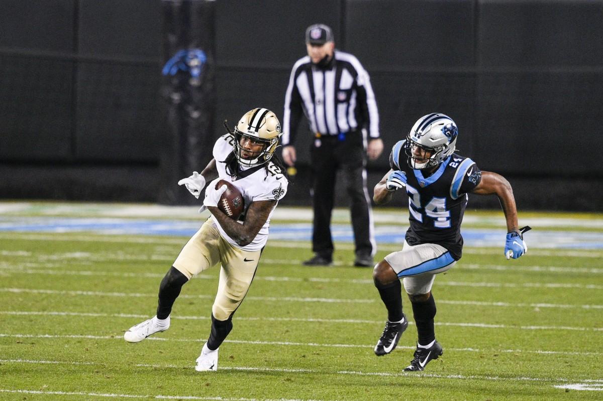 Jan 3, 2021; Charlotte, North Carolina, USA; Saints wide receiver Marquez Callaway (12) with the ball as Panthers cornerback Rasul Douglas (24) defends at Bank of America Stadium. Mandatory Credit: Bob Donnan-USA TODAY
