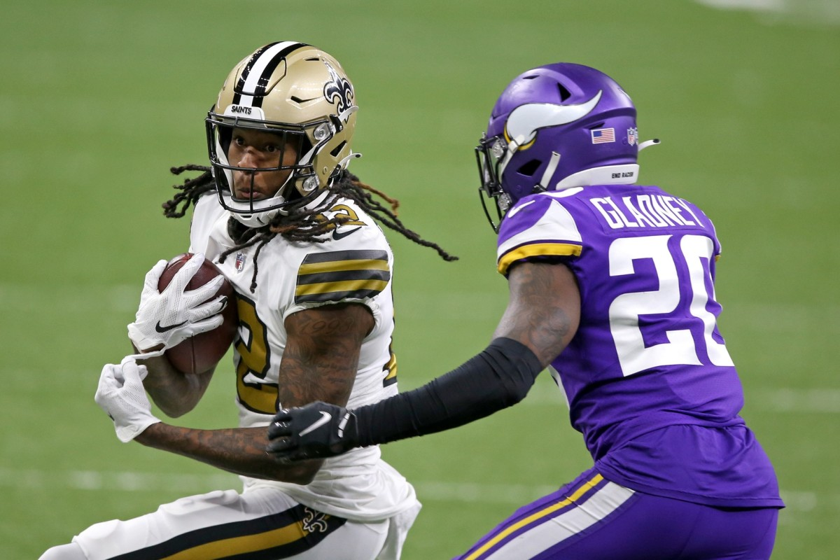 Dec 25, 2020; New Orleans, Louisiana, USA; Saints wide receiver Marquez Callaway (12) is defended by Vikings cornerback Jeff Gladney (20) at the Mercedes-Benz Superdome. Mandatory Credit: Chuck Cook-USA TODAY