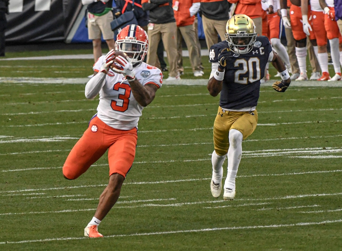 Rodgers catches a pass for a 67-yard touchdown against Notre Dame.