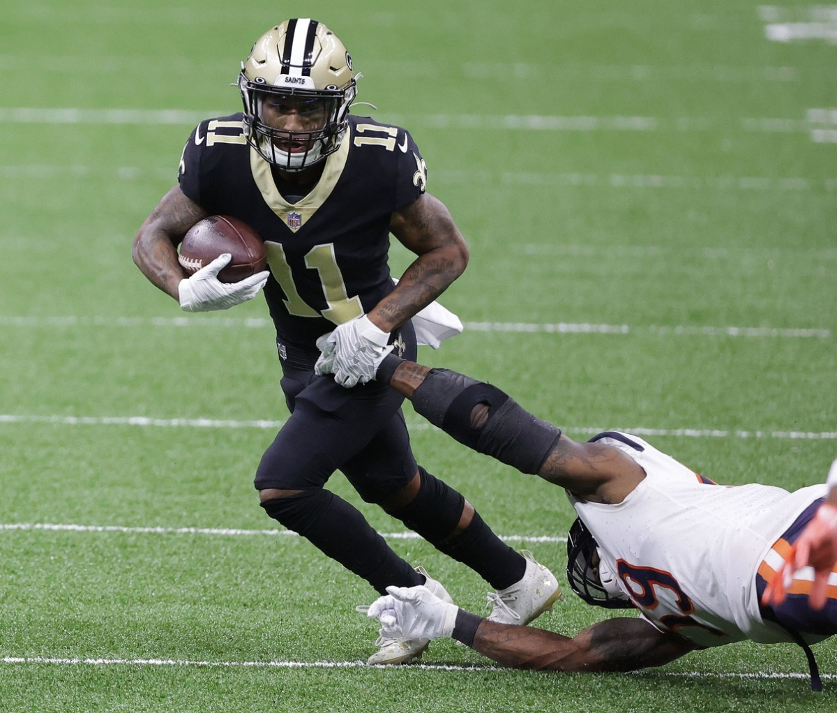 Jan 10, 2021; New Orleans, Louisiana, USA; Saints wide receiver Deonte Harris (11) runs the ball against the Bears in the NFC Wild Card game at Mercedes-Benz Superdome. Mandatory Credit: Derick E. Hingle-USA TODAY