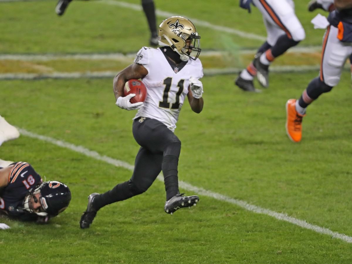 Nov 1, 2020; Chicago, Illinois, USA; New Orleans wide receiver Deonte Harris (11) runs with the ball during the second half against Chicago at Soldier Field. Mandatory Credit: Dennis Wierzbicki-USA TODAY