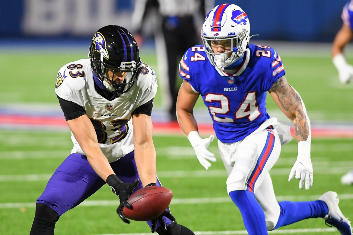 Jan 16, 2021; Orchard Park, New York, USA; Baltimore wide receiver Willie Snead (83) catches a pass as Bills cornerback Taron Johnson (24) defends during an AFC Divisional Round game at Bills Stadium. Mandatory Credit: Rich Barnes-USA TODAY