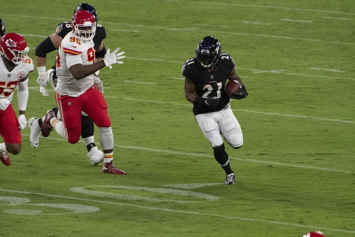 Sep 28, 2020; Baltimore, Maryland, USA; Ravens running back Mark Ingram II (21) rushes against the Kansas City Chiefs at M&T Bank Stadium. Mandatory Credit: Tommy Gilligan-USA TODAY