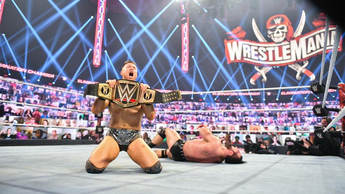 The Miz poses with the WWE championship at Elimination Chamber