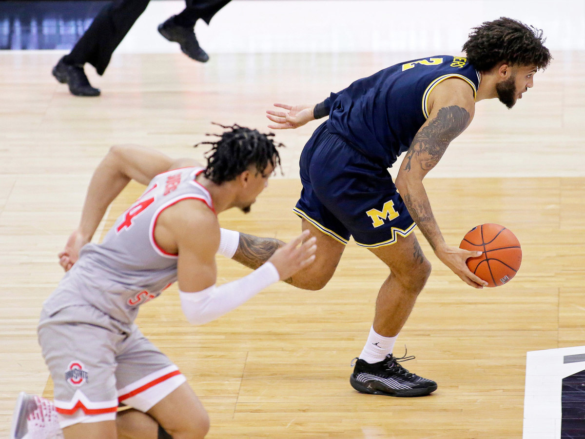 Michigan's Isaiah Livers dribbles away from Ohio State