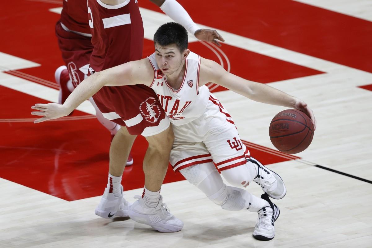 Jan 14, 2021; Salt Lake City, Utah, USA; Utah Utes guard Rylan Jones (15) dribbles around Stanford Cardinal guard Michael O'Connell (5) in the second half at Jon M. Huntsman Center.