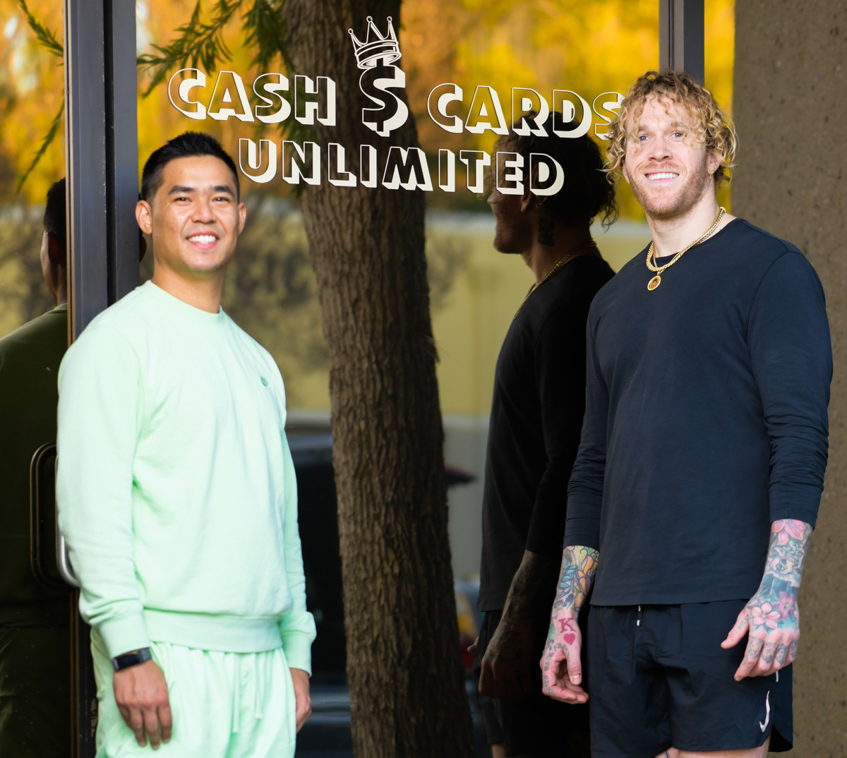 Cassius Marsh and business manager Nick Nugwynne outside their new store selling collectible cards in Westlake Village, California