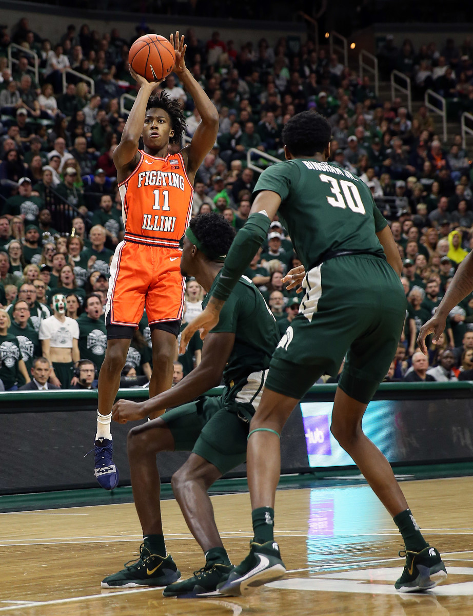 Illinois Fighting Illini guard Ayo Dosunmu (11) attempts a three point basket over Michigan State Spartans forward Gabe Brown (44) during the first half of the 2019 game at the Breslin Center.