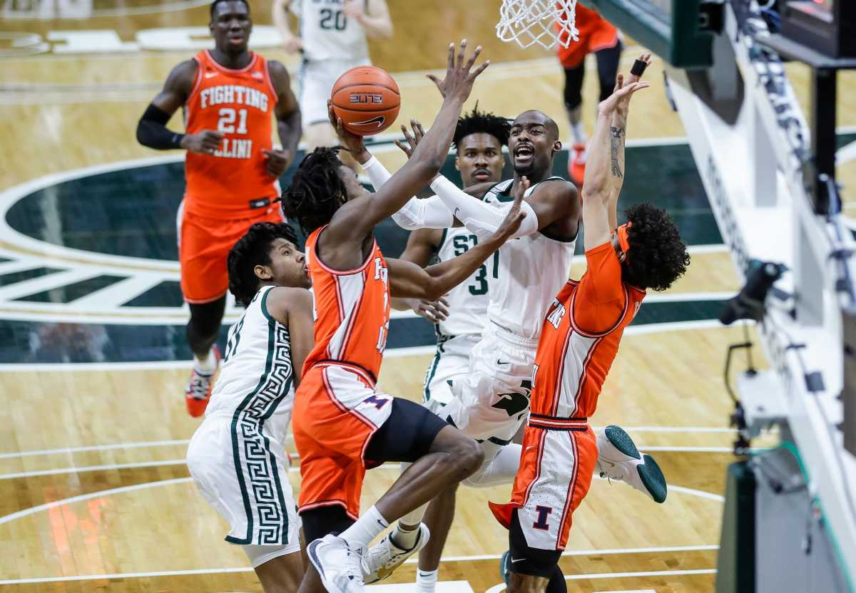 Michigan State guard Joshua Langford (1) makes a layup against Illinois guard Trent Frazier (1) during the second half at the Breslin Center in East Lansing, Tuesday, Feb. 23, 2021.