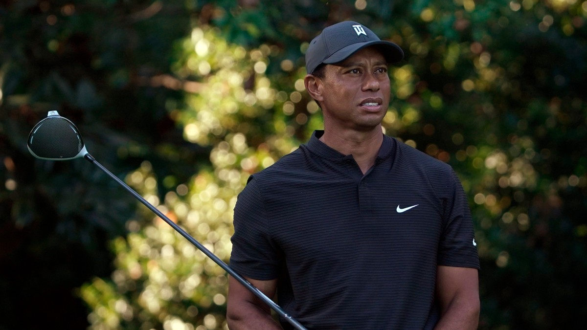 Tiger Woods holding a golf club