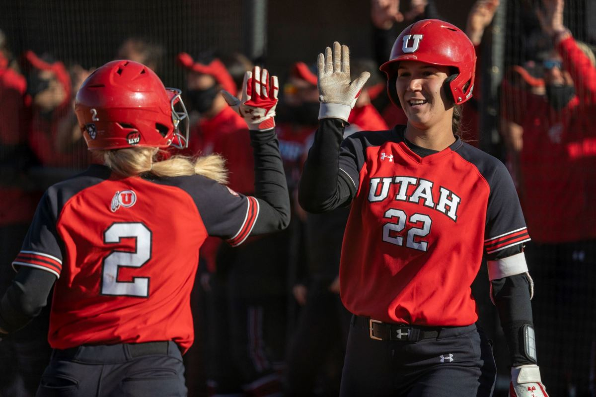 Utah softball's Ellessa Bonstrom (2) high-fives teammate Halle Morris (22) during the UNLV Desert Classic — Courtesy of Utah Athletics