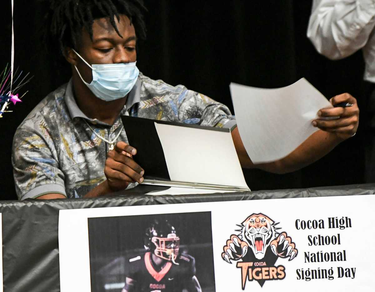 Kionte Curry signs his letter of intent during Signing Day at Cocoa High School on Feb. 3, 2021.