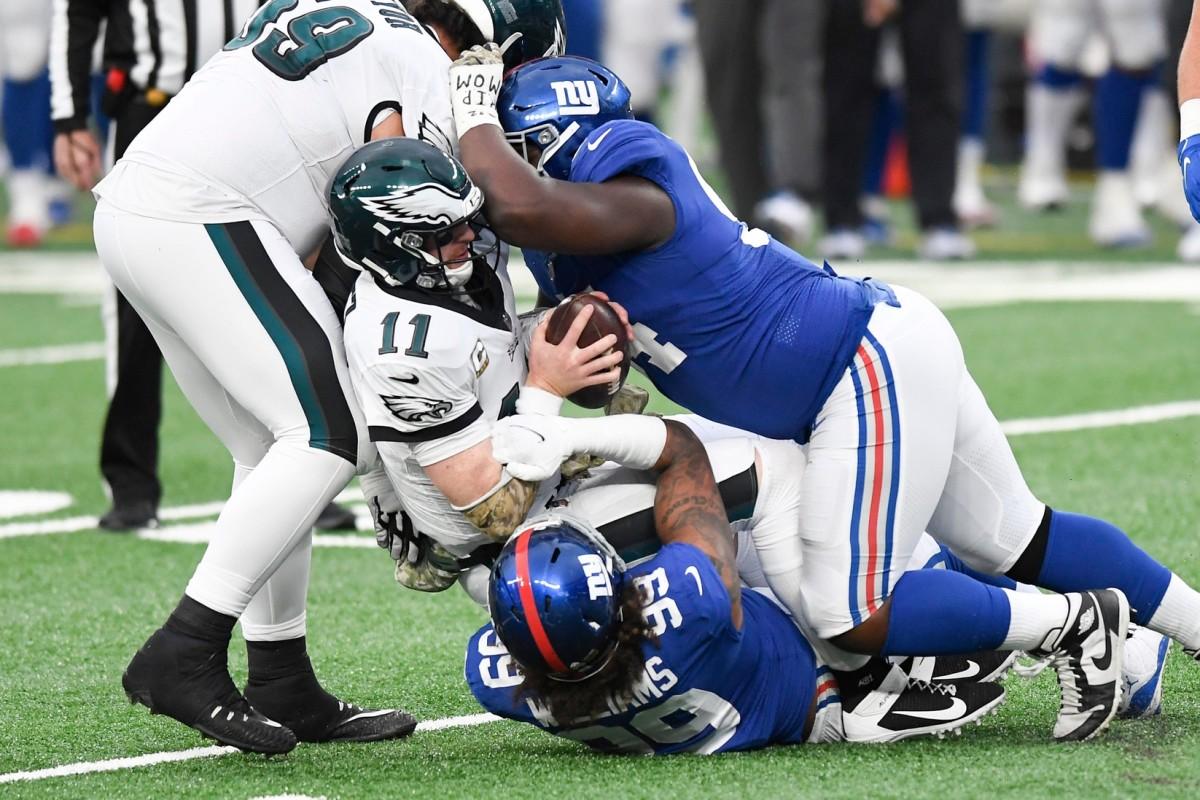 New York Giants defensive end Leonard Williams (99) and lineman Dalvin Tomlinson (94) sack Philadelphia Eagles quarterback Carson Wentz (11) in the second half. The Giants defeat the Eagles, 27-17, at MetLife Stadium on Sunday, Nov. 15, 2020.