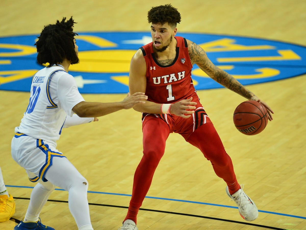 Dec 31, 2020; Los Angeles, California, CA; Utah Utes forward Timmy Allen (1) controls the ball against UCLA Bruins guard Tyger Campbell (10) during the second half at Pauley Pavilion.