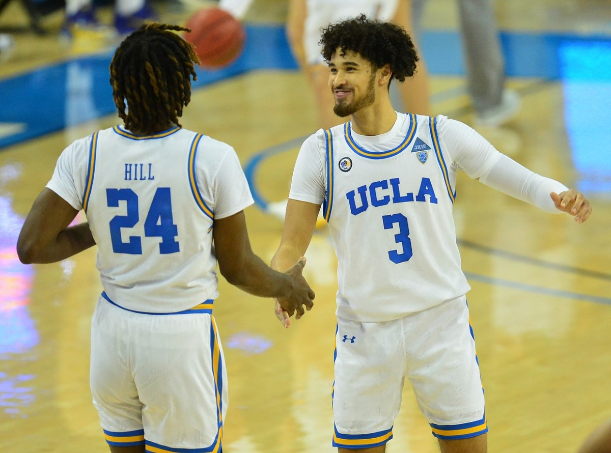 Dec 31, 2020; Los Angeles, California, CA; UCLA Bruins guard Johnny Juzang (3) and forward Jalen Hill (24) celebrate the 72-70 victory against the Utah Utes at Pauley Pavilion.