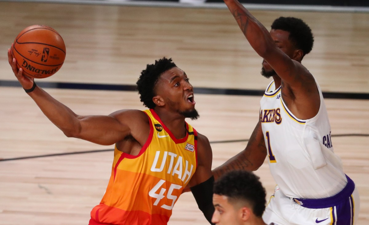 Donovan Mitchell (45) drives through the paint for a layup