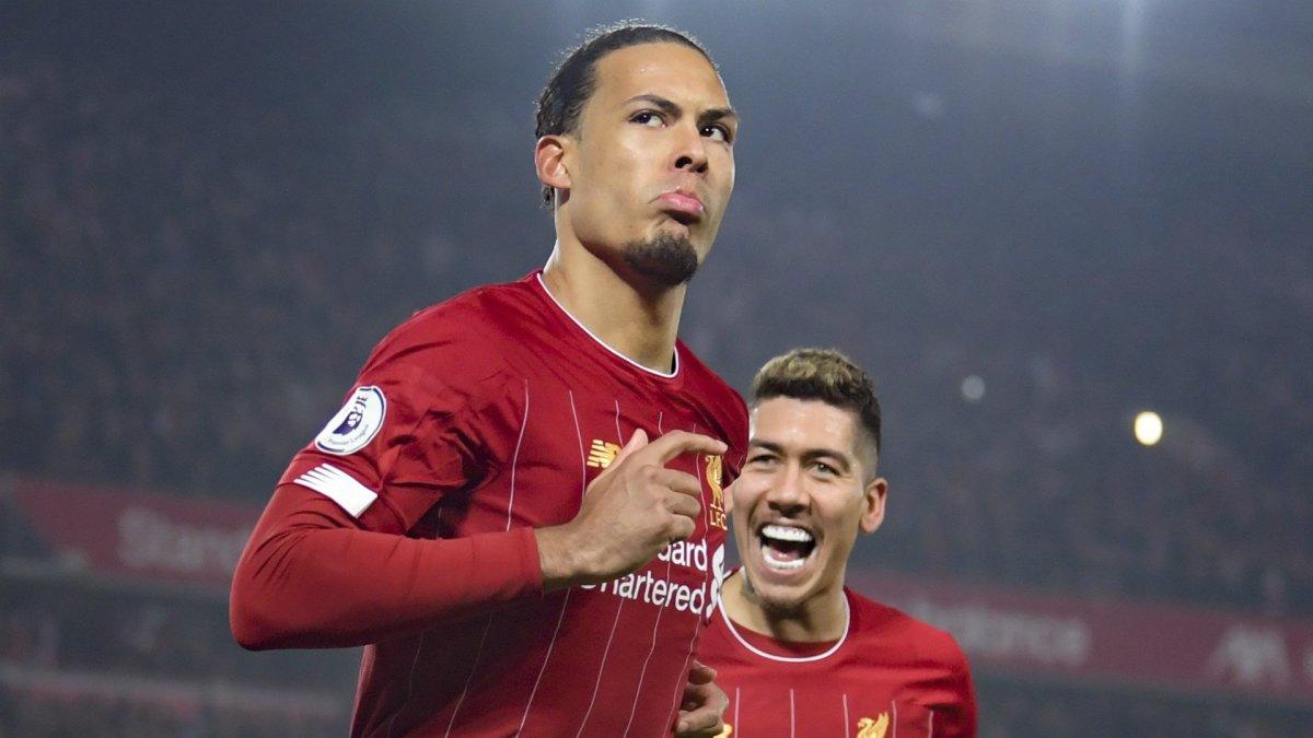 Virgil van Dijk celebrating a goal for Liverpool FC with Roberto Firmino.