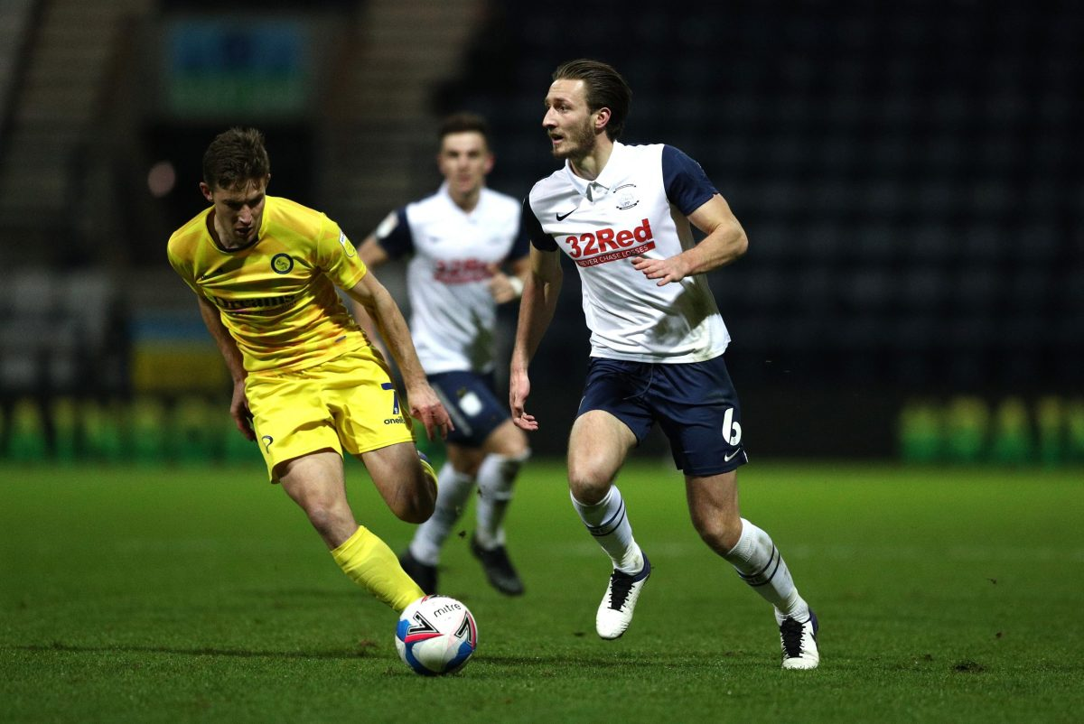 PRESTON, ENGLAND - DECEMBER 05: Ben Davies of Preston North End controls the ball from David Wheeler of Wycombe Wanderers during the Sky Bet Championship match between Preston North End and Wycombe Wanderers at Deepdale on December 05, 2020 in Preston, England. (Photo by Jan Kruger/Getty Images)