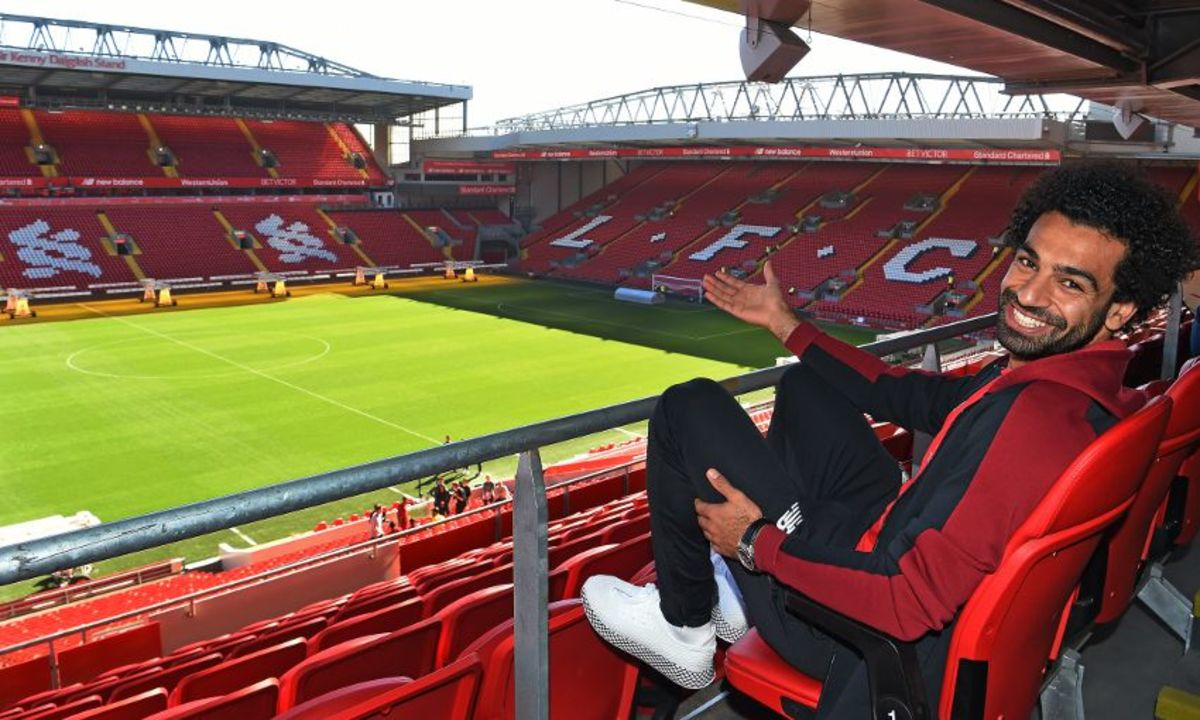 Liverpool Mohamed Salah pointing to Anfield.