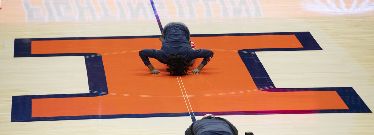 Illinois Fighting Illini guard Ayo Dosunmu (11) kisses the floor during senior night prior to a game against the Nebraska Cornhuskers at the State Farm Center.