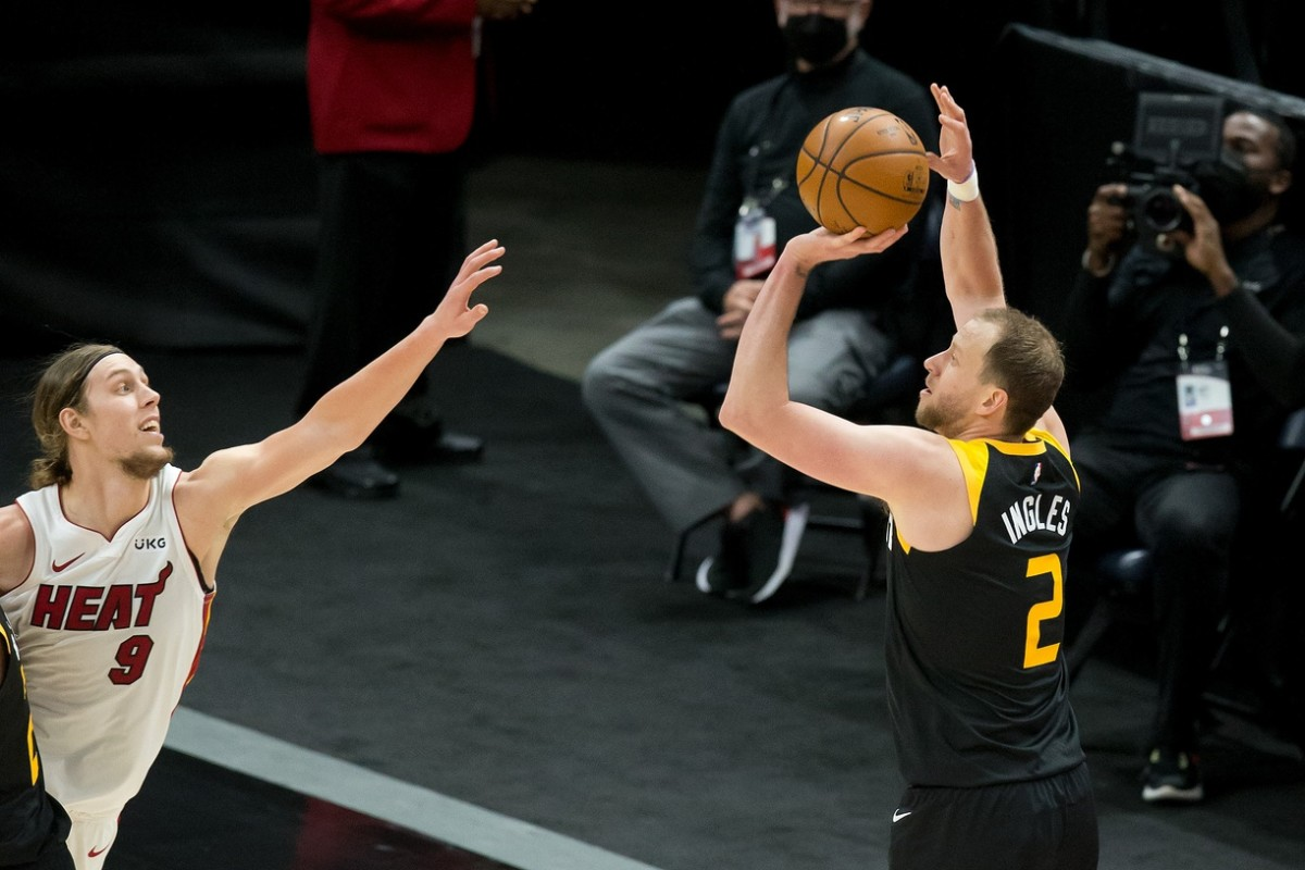 Joe Ingles (2) shoots a three-pointer over Kelly Olynyk (9)
