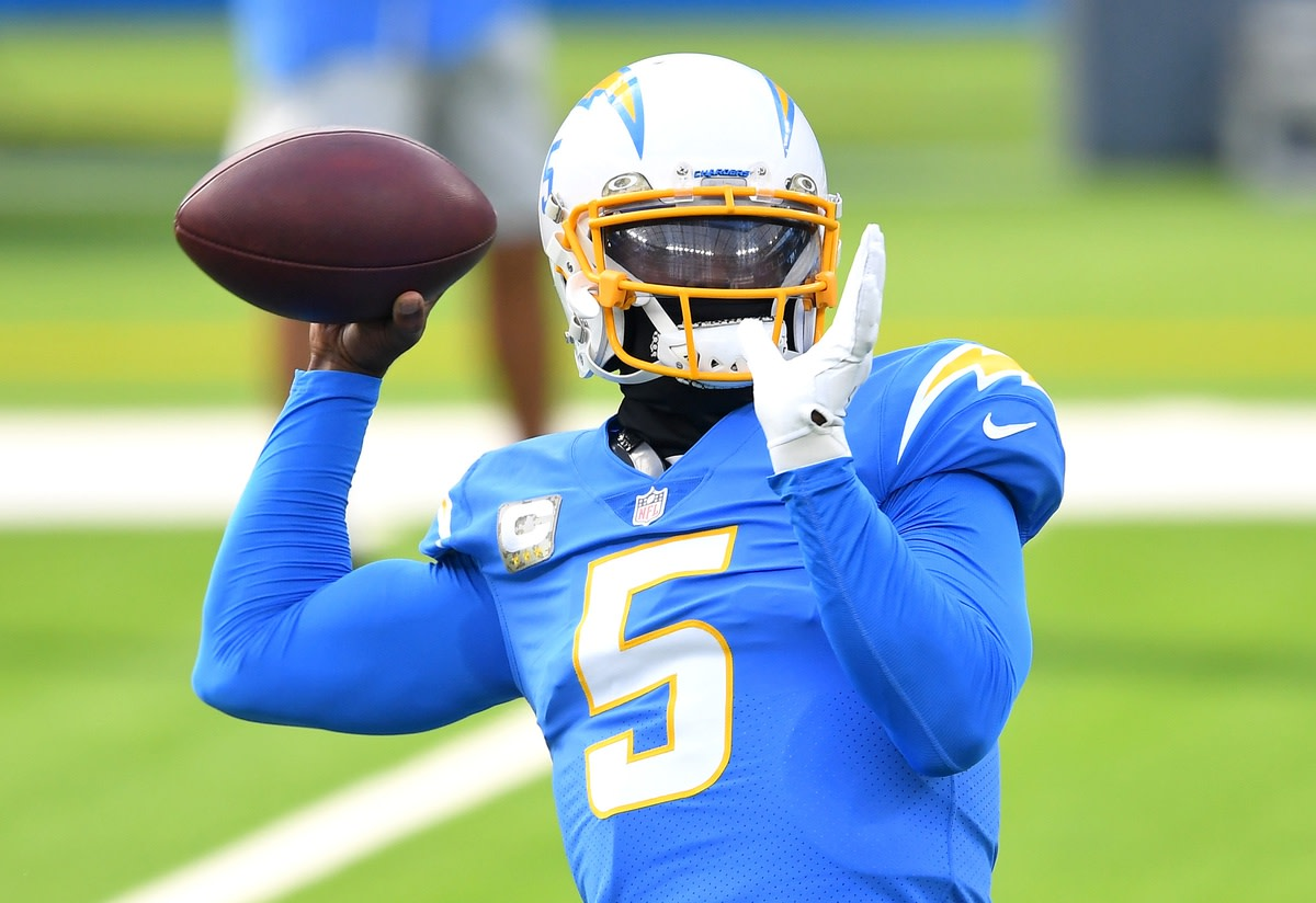 Los Angeles Chargers quarterback Tyrod Taylor (5) warms up before a game against the New York Jets at SoFi Stadium.