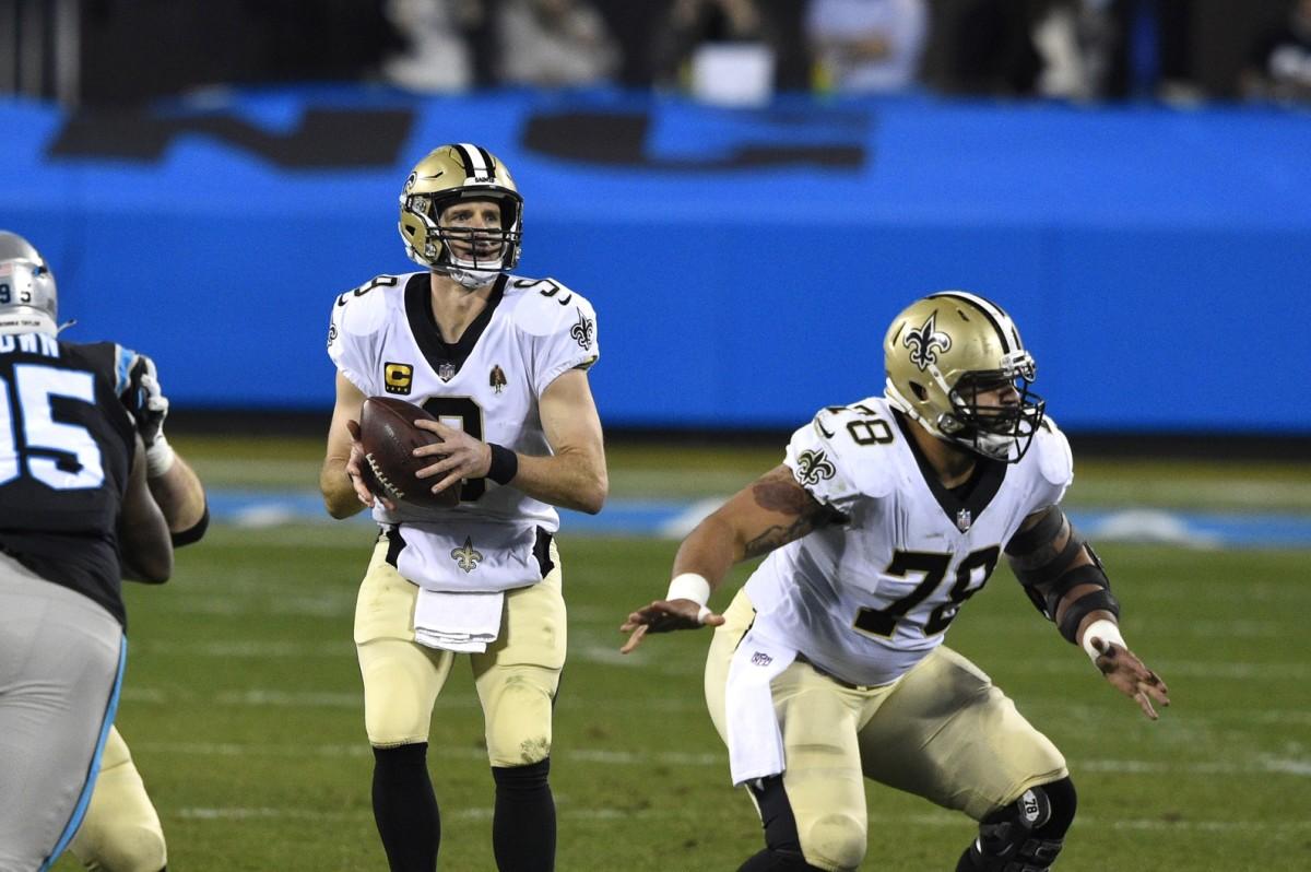 Jan 3, 2021; Charlotte, North Carolina, USA; Saints quarterback Drew Brees (9) looks to pass as center Erik McCoy (78) blocks at Bank of America Stadium. Mandatory Credit: Bob Donnan-USA TODAY Sports