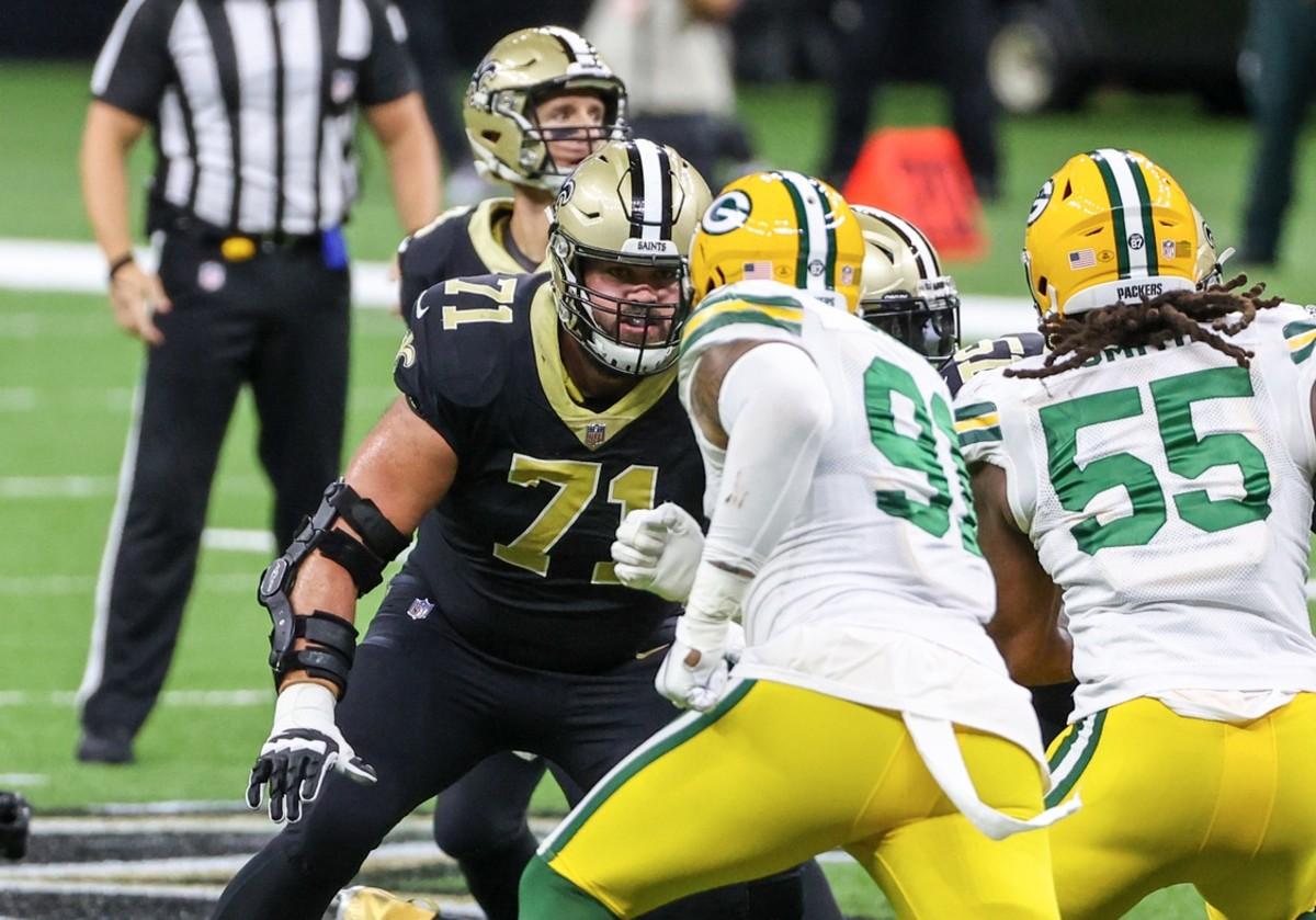 Sep 27, 2020; New Orleans, Louisiana, USA; Saints offensive tackle Ryan Ramczyk (71) blocks Green Bay linebacker Preston Smith (91). Mandatory Credit: Derick E. Hingle-USA TODAY Sports