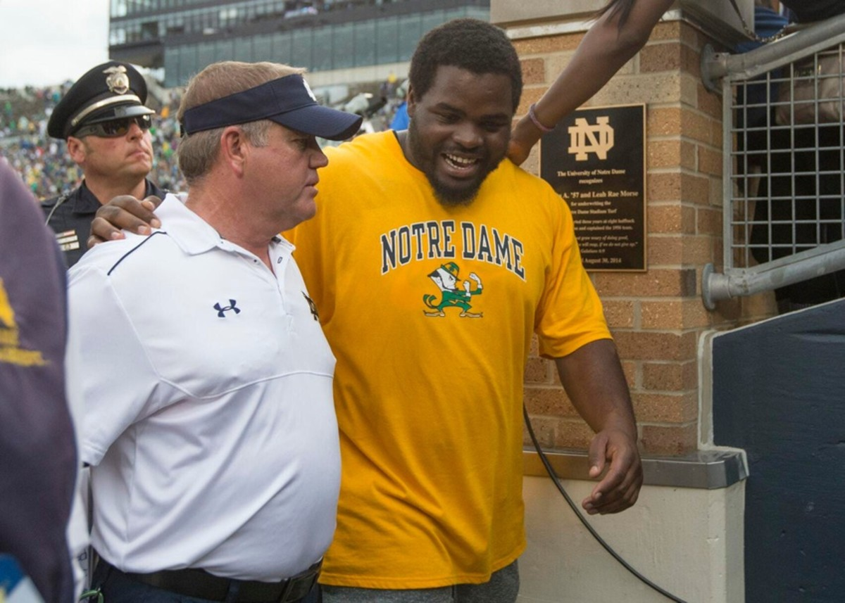 Former Irish nose guard Louis Nix III visits with Notre Dame coach Brian Kelly after Nix attended ND s 2014 season opener with Rice, months after getting drafted by the Houston Texans.