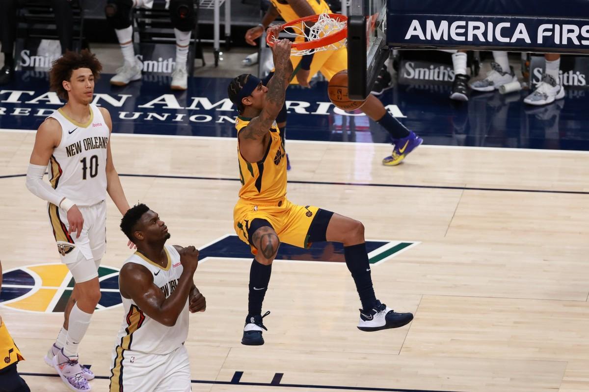 Jordan Clarkson (00) dunks over Zion Williamson (1)