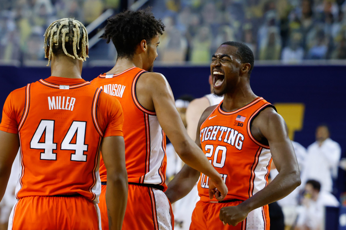 Illinois guard Da'Monte Williams (20) and guard Jacob Grandison (3) celebrate a play against Michigan during the first half Tuesday, March 2, 2021, at the Crisler Center in Ann Arbor.
